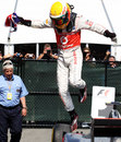 Lewis Hamilton jumps from his car in parc ferme