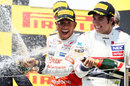 Lewis Hamilton and Sergio Perez celebrate on the podium