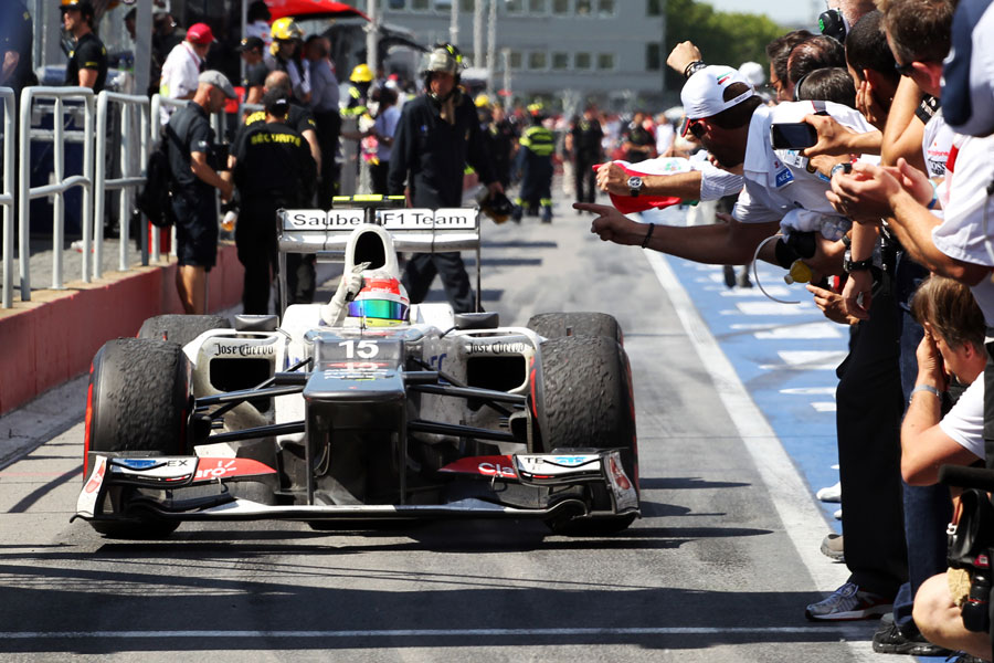 Sergio Perez celebrates as he returns to parc ferme