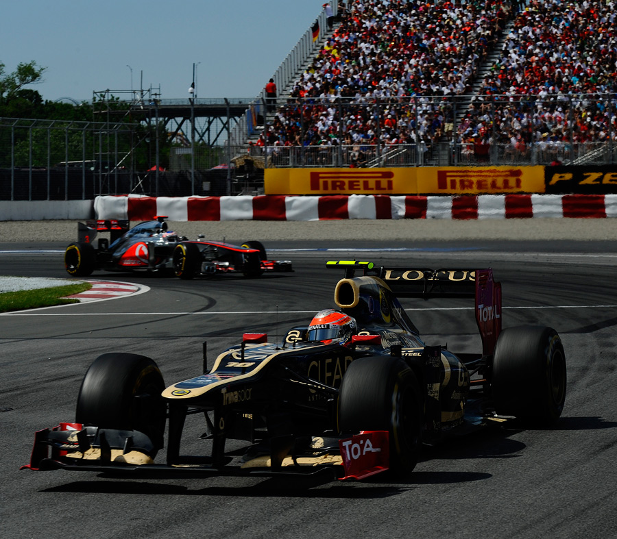 Romain Grosjean leads Jenson Button