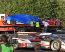 Anthony Davidson's Toyota and the Ferrari 458 Italia are tended to after crashing at Le Mans