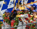 The Audi team celebrates victory at Le Mans