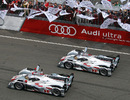 Audi's Andre Lotterer takes the chequered flag ahead of team-mate Tom Kristensen at Le Mans