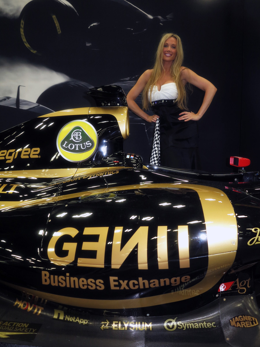 A glamour model poses with a Lotus at the Formula One Expo in Austin