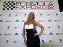 A glamour model poses  at the Formula One Expo in Austin