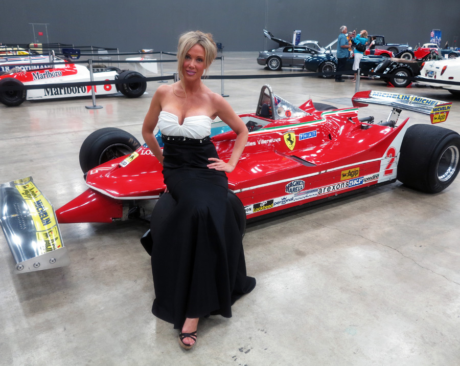 A glamour model poses with Gilles Villeneuve's 312T- 5 Ferrari at the Formula One Expo in Austin