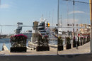 Valencia's harbour reflected in the McLaren motorhome