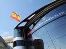 A Spanish flag flies above the McLaren motorhome