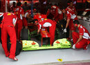 Fernando Alonso's Ferrari doused in aero paint at the start of first practice