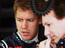 Sebastian Vettel talks with Christian Horner in the Red Bull garage