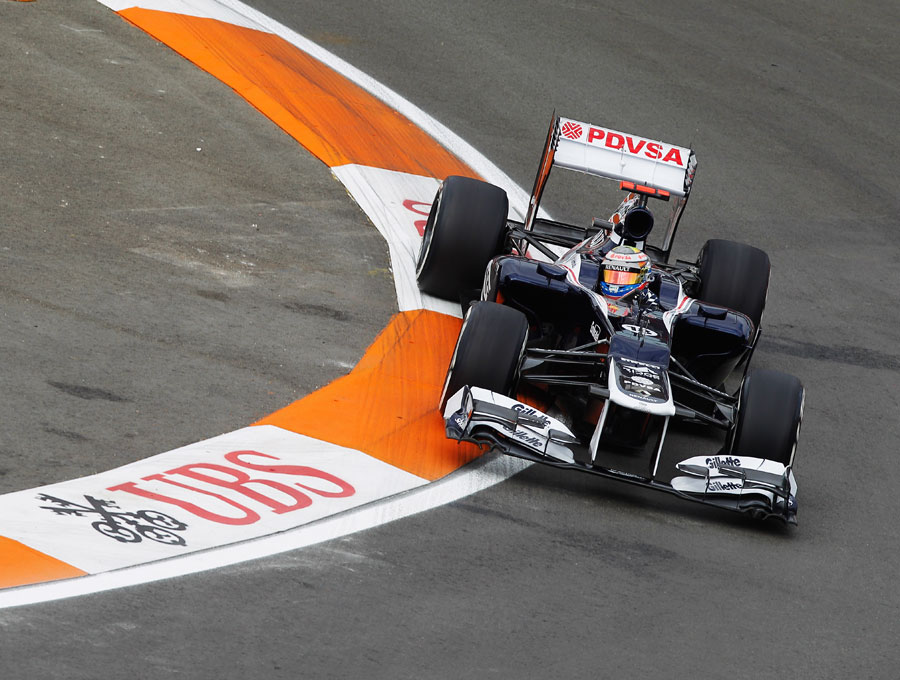 Pastor Maldonado attacks the kerbs during first practice