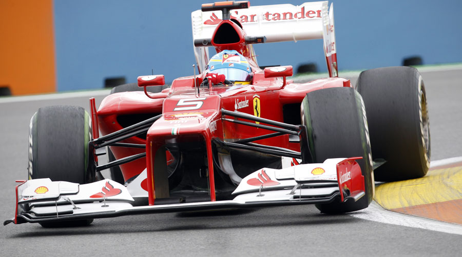 Fernando Alonso looks to get the power down