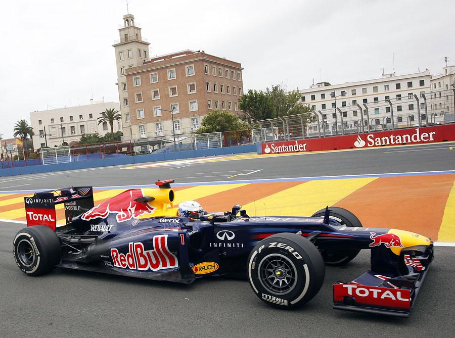 Sebastian Vettel returns to the pits in the Red Bull