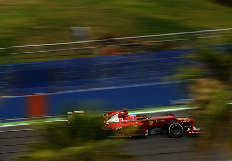 Fernando Alonso attacks a high-speed part of the circuit