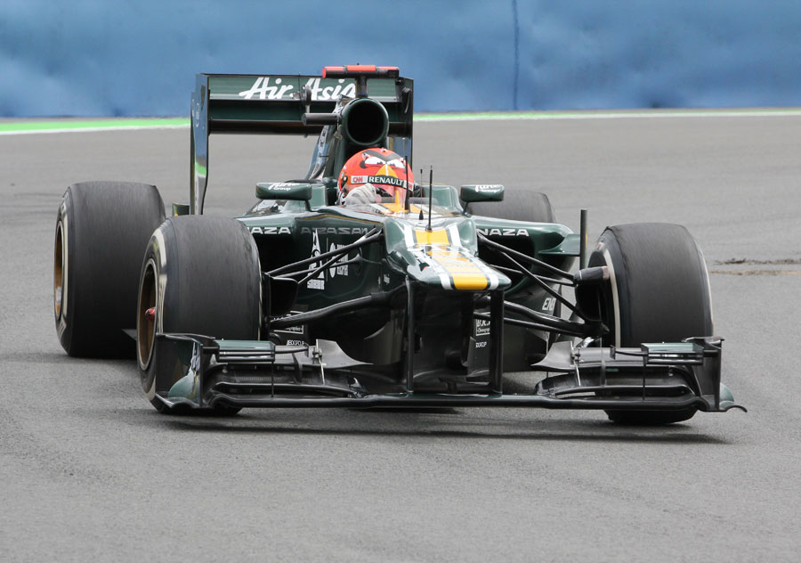 Heikki Kovalainen looks for grip on the medium tyres