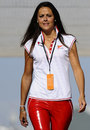 A Ferrari employee arrives in the paddock