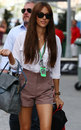 Jenson Button's girlfriend Jessica Michibata arrives in the paddock
