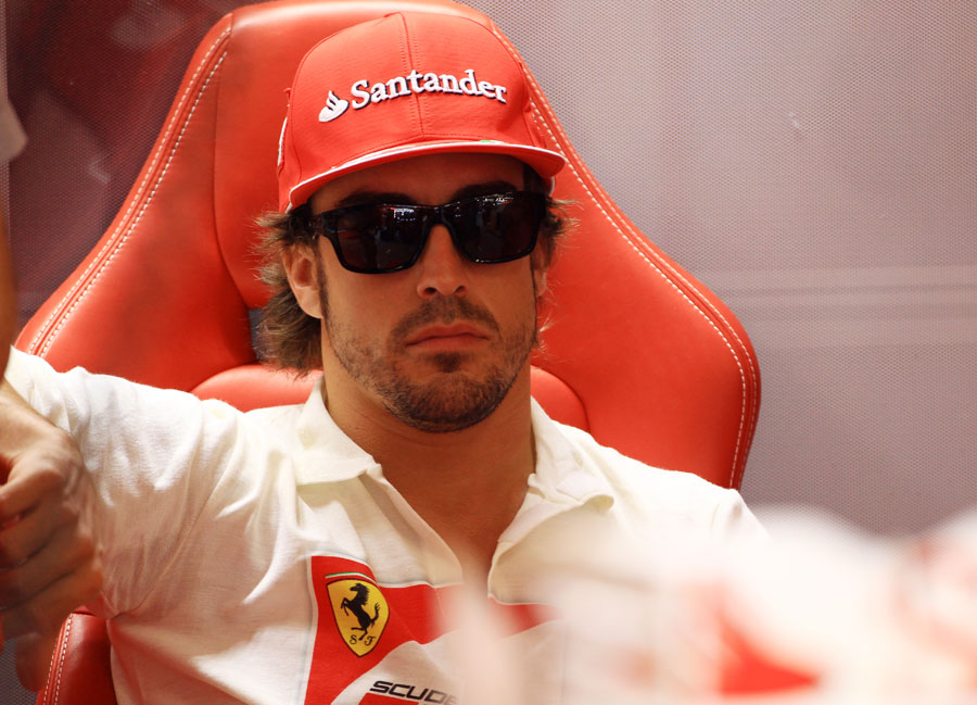 Fernando Alonso relaxes in the Ferrari garage
