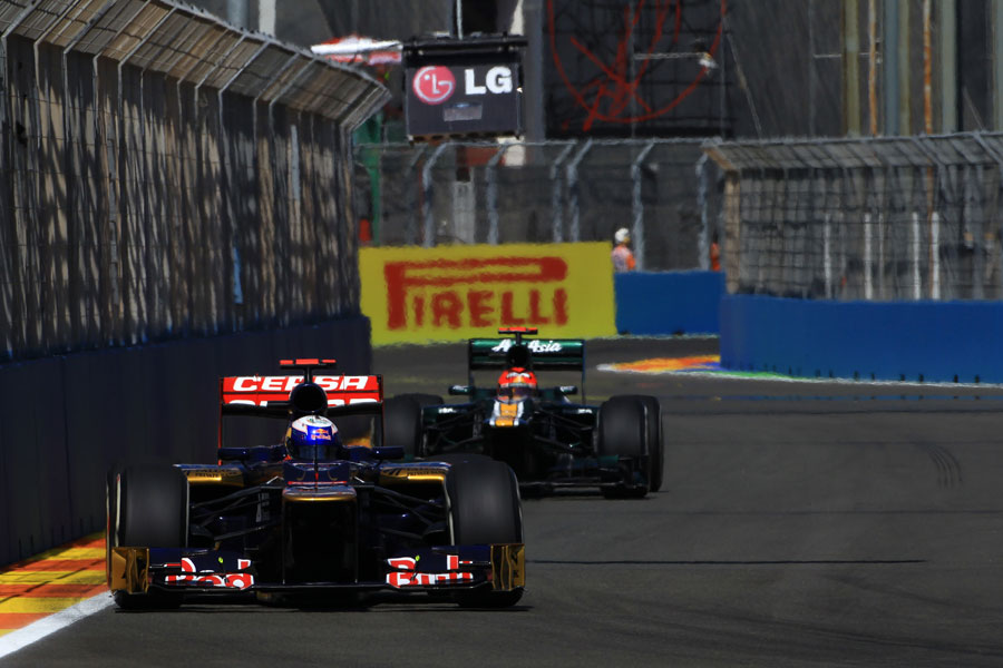 Jean Eric Vergne leads Heikki Kovalainen on track