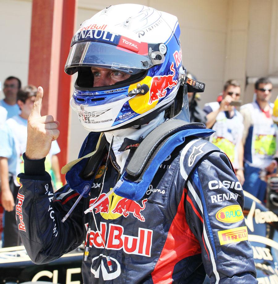 Sebastian Vettel celebrates pole position in parc ferme