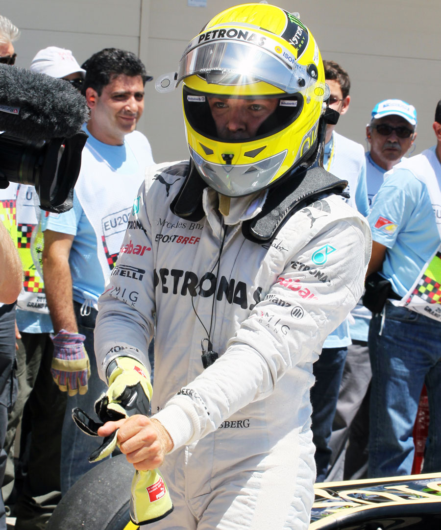 Nico Rosberg gets out of his car in parc ferme