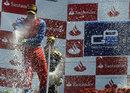 Luiz Razia celebrates victory on the podium with James Calado