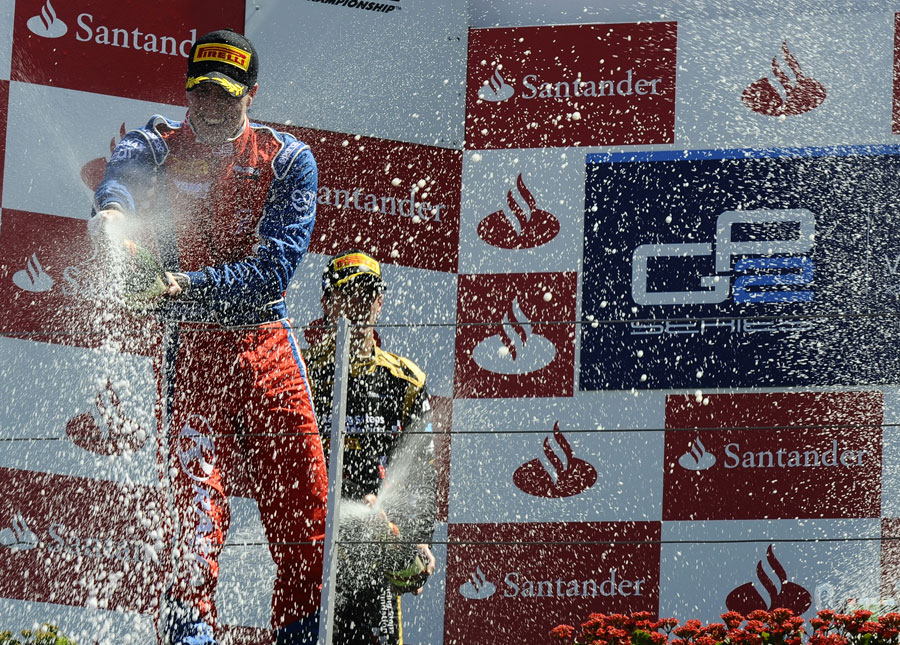 Luiz Razia celebrates victory on the podium with James Calado