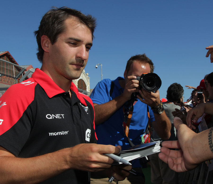 Timo Glock signs autographs