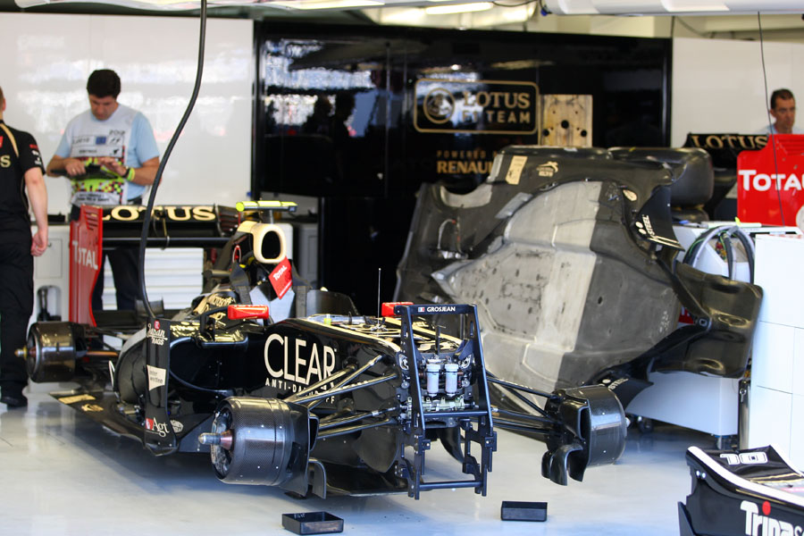 Romain Grosjean's car and a spare floor in the Lotus garage