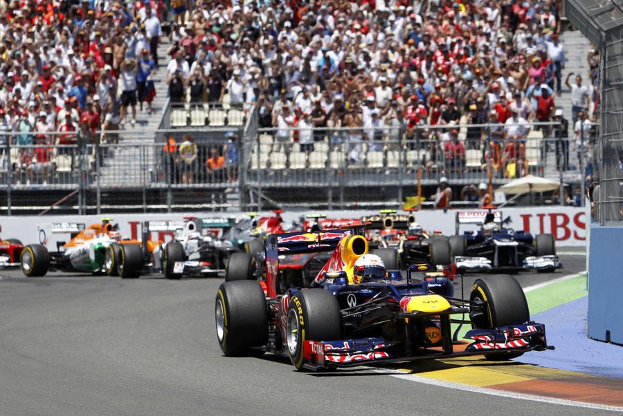 Sebastian Vettel leads out of the second corner