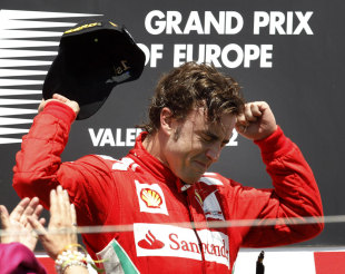 Fernando Alonso celebrates an emotional victory in the European Grand Prix on the podium
