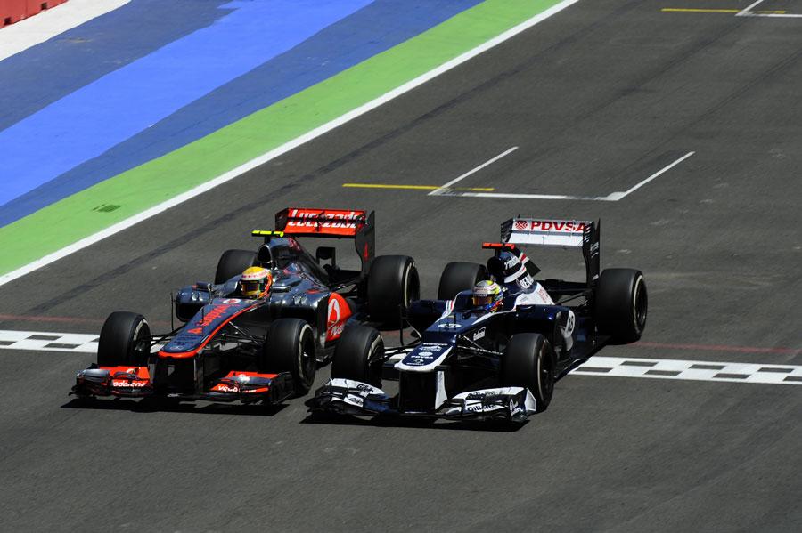 Lewis Hamilton and Pastor Maldonado go wheel to wheel