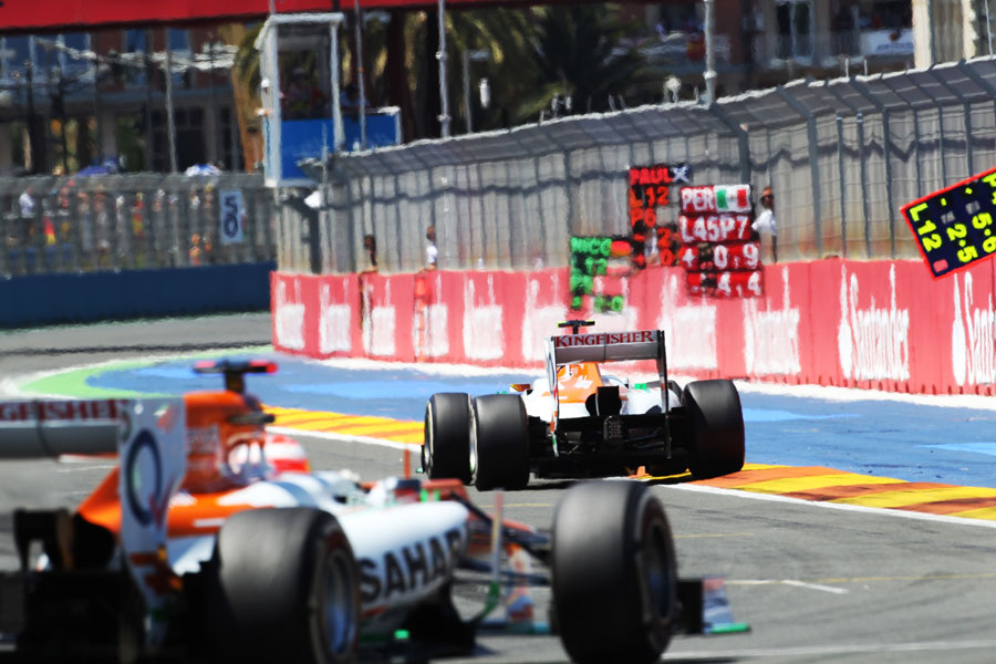 Nico Hulkenberg leads Paul di Resta out of the final corner