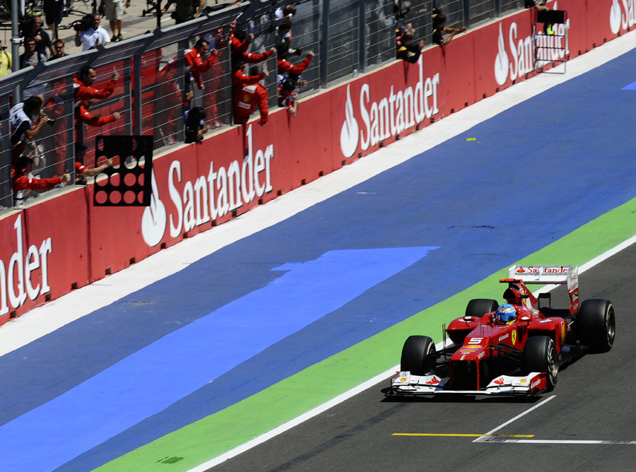 Fernando Alonso crosses the line for victory