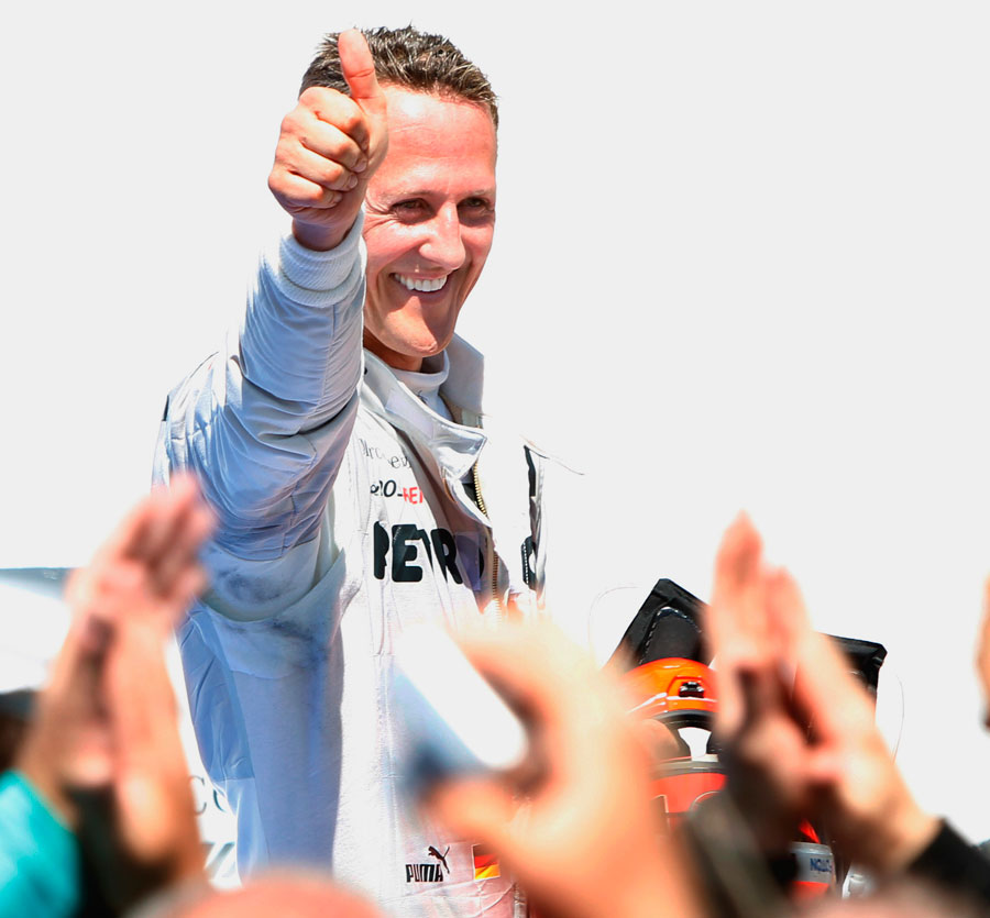 Michael Schumacher celebrates his first podium since his comeback