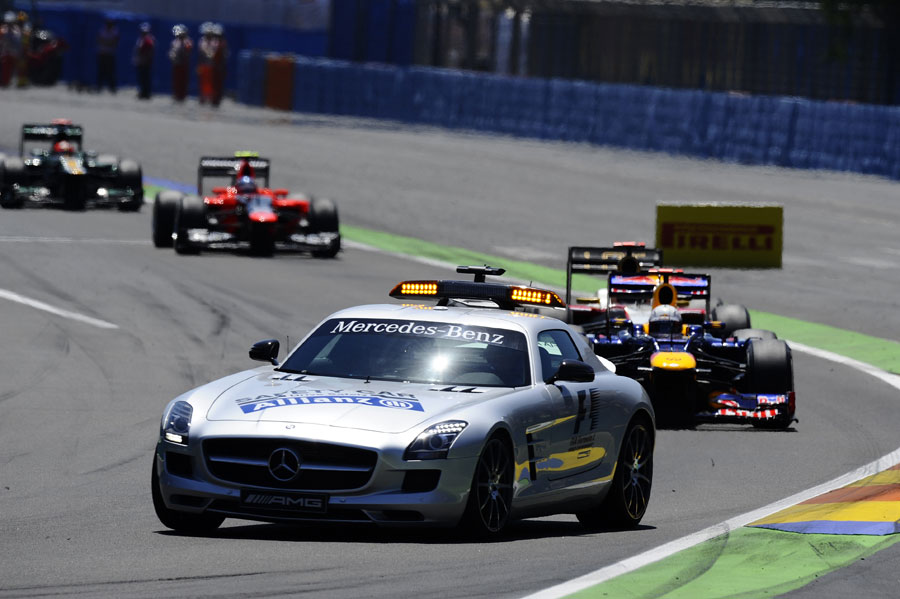 Sebastian Vettel leads the field behind the safety car