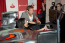 Jenson Button teaches Radio 1Xtra DJ Sarah Jane Crawford how to drive at the London Grand Prix VIP Event