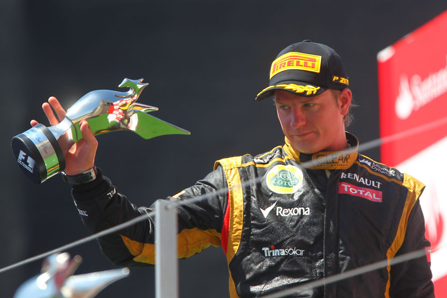 Kimi Raikkonen with his trophy on the podium