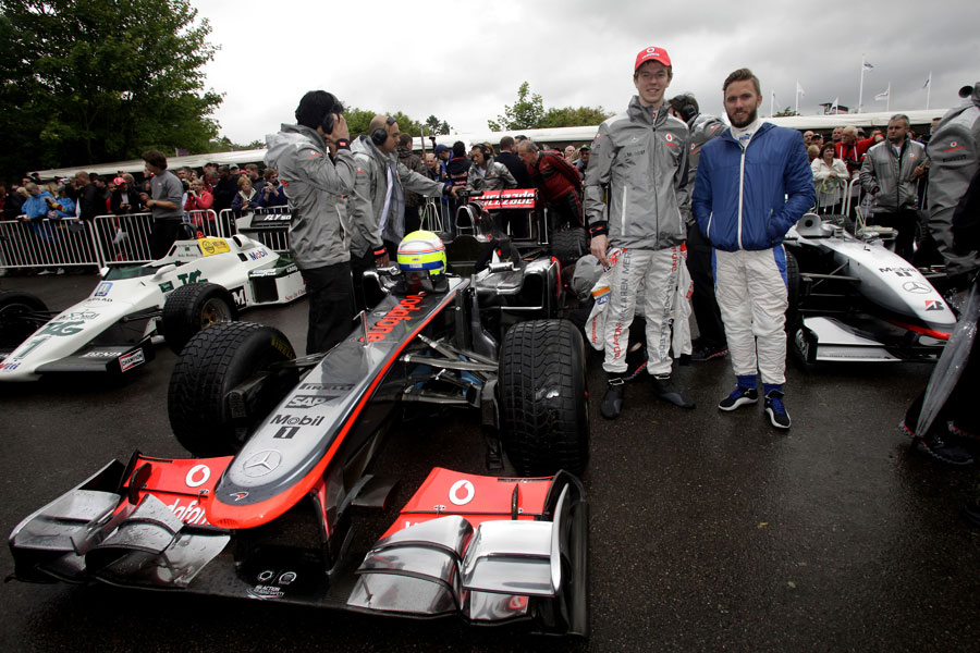 Oliver Turvey and Nick Heidfeld in the Formula One holding bay