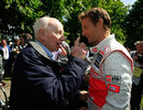 Former champions Jenson Button and John Surtees chat at the Festival of Speed