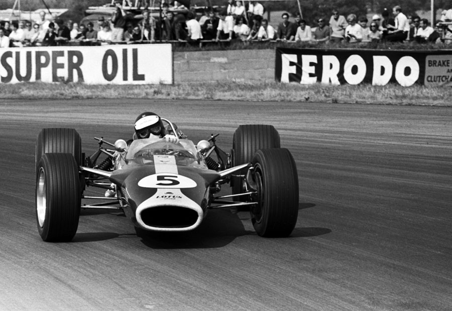 Jim Clark holds a huge slide in Lotus 49