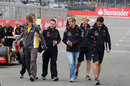 Sebastian Vettel walks the track with his team of engineers