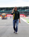 Vitaly Petrov walks the track on Thursday