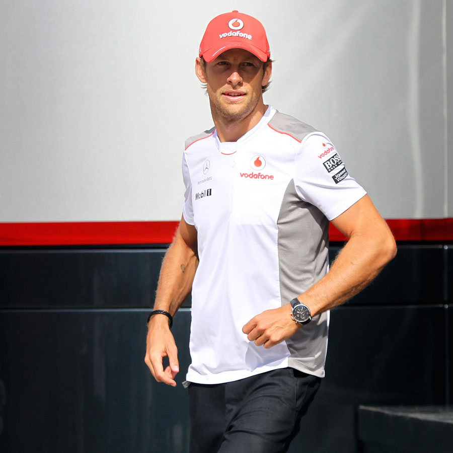 Jenson Button walks out of the McLaren motorhome on Thursday