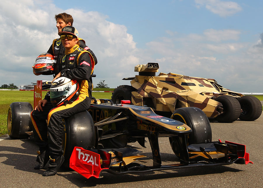 Lotus drivers Romain Grosjean and Kimi Raikkonen pose for a photoshoot promoting the new Batman film
