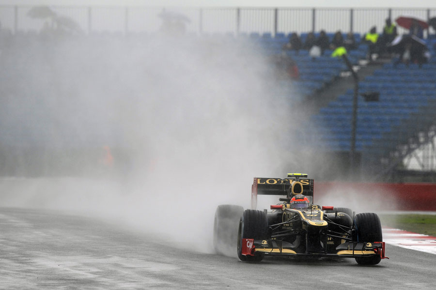 Romain Grosjean heads through the rain towards Vale