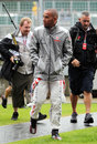 Some kind of a summer ... Lewis Hamilton arrives at soggy Silverstone