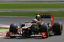 Kimi Raikkonen holds a slide in his Lotus