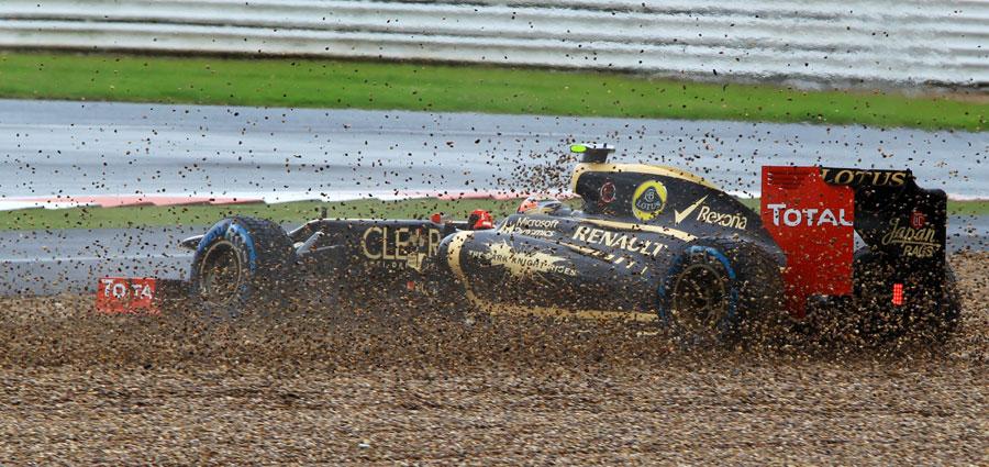 Romain Grosjean  spins into the gravel