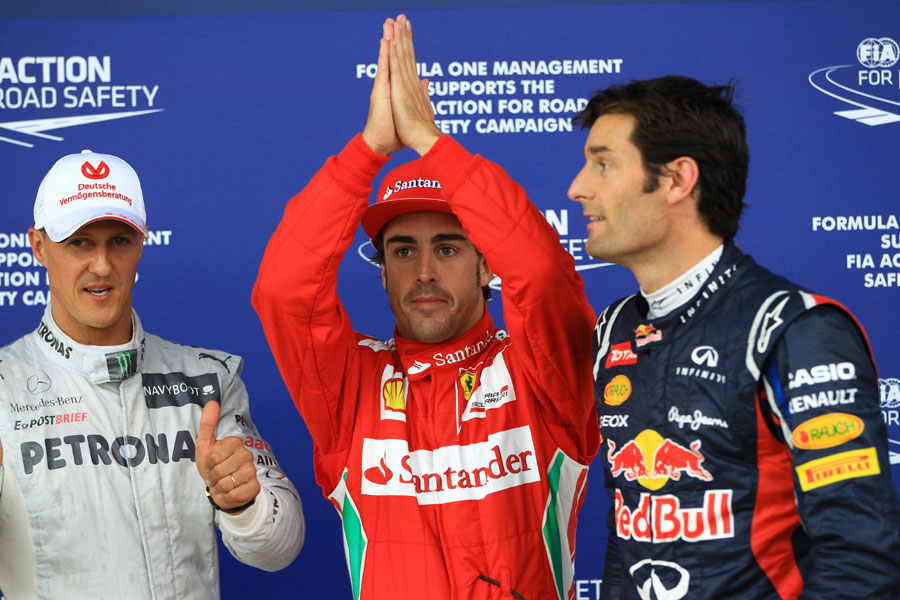Michael Schumacher, Fernando Alonso and Mark Webber celebrate taking the top three places on the grid